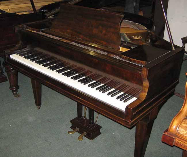 Rogers baby grand before being restored
